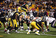 Pittsburgh Steelers strong safety Troy Polamalu (43) flies over a pile of defensive and offensive linemen on a goal line stand in the fourth quarter during the NFL week 7 regular season football game against the Houston Texans on Monday, Oct. 20, 2014 in Pittsburgh. The Steelers won the game 30-23. ©Paul Anthony Spinelli
