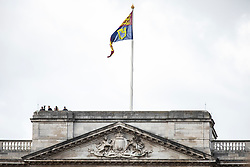 © Licensed to London News Pictures. 03/06/2019. London, UK. Police officers keep watch from the roof of Buckingham Palace ahead of the arrival of President of the United States Donald Trump. President Trump is in the UK for a three-day State Visit. Photo credit: Rob Pinney/LNP