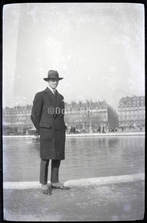 male person standing in public park Paris 1900s