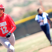 041313       Adron Gardner/Independent<br /> <br /> Monument Valley Mustang Tiara John (12) breaks for home from third base to score on the Window Rock Scouts in Fort Defiance Saturday.