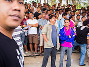 08 FEBRUARY 2014 - PHAWONG, SONGKHLA, THAILAND:  Spectators at a bullfight in rural Songkhla province, Thailand. Bullfighting is a popular past time in southern Thailand. Hat Yai is the center of Thailand's bullfighting culture. In Thai bullfights, two bulls are placed in an arena and they fight, usually by head butting each other, until one runs away or time is called. Huge amounts of mony are wagered on Thai bullfights - sometimes as much as 2,000,000 Thai Baht ($65,000 US).   PHOTO BY JACK KURTZ