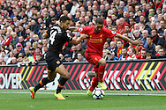 Roberto Firmino of Liverpool is held back by Jake Livermore of Hull City. Premier League match, Liverpool v Hull City at the Anfield stadium in Liverpool, Merseyside on Saturday 24th September 2016.<br /> pic by Chris Stading, Andrew Orchard sports photography.