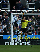Photo: Andrew Unwin.<br />Newcastle United v Bolton Wanderers. The Barclays Premiership. 04/03/2006.<br />Bolton's goalkeeper, Jussi Jaaskelainen (R), punches the ball away from Newcastle's Alan Shearer (L).