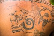 27 NOVEMBER 2012 - BANGKOK THAILAND: A tattoo of a demon on a monk's back at Wat Sri Boonreung on Klong Saen Saeb in Bangkok, Thailand.       PHOTO BY JACK KURTZ