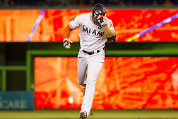 July 17, 2017 - USA - Marlins outfielder Giancarlo Stanton blasts a home run in the first inning as the Miami Marlins play the Philadelphia Phillies at Marlins Park on Monday, July 17, 2017 in Miami. (Credit Image: © Bryan Cereijo/TNS via ZUMA Wire)