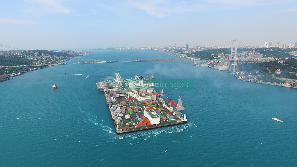 May 31, 2017 - Istanbul, Turkey - Istanbul's Bosphorus Strait was closed to traffic on May 31 due to the transiting of the Pioneering Spirit vessel, which will carry out the construction of the Turkish Stream natural gas pipeline's offshore section. Ferry lines have also been suspended.  It arrived at the Çanakkale Strait early on May 30, according to the vessel's Swiss owner, Allseas. Officials from Allseas told state-run Anadolu Agency the vessel's final destination would be Anapa on the northern Black Sea coast in Russia, where the first pipe-laying for the Turkish Stream project will start. The 382-meter-long and 124-meter-wide vessel is expected to arrive in Anapa on June 2. A shipping data revealed that a Maltese-flagged ship departed from the Netherlands on May 13. (Credit Image: © Ali Aksoyer/Depo Photos via ZUMA Wire)