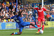 AFC Wimbledon defender Deji Oshilaja (4) stretching for the ball during the EFL Sky Bet League 1 match between AFC Wimbledon and Scunthorpe United at the Cherry Red Records Stadium, Kingston, England on 15 September 2018.