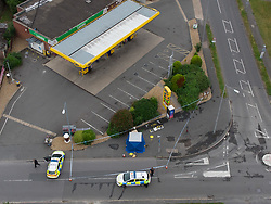 © Licensed to London News Pictures. 31/07/2021. High Wycombe, UK. Police vehicles form a cordon around a forensic tent outside a Jet petrol station as a major police investigation gets underway in High Wycombe, unconfirmed reports on social media indicate that a person was stabbed to death in the early hours of Sunday morning 31 July 2021. Photo credit: Peter Manning/LNP