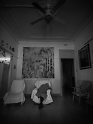 """Mrs. Feli rests with a blanket over her body, born in 1916 in the Basque Country, Spain. She suffers from Alzheimer's disease, pictured at the Gure Etxea residence in Barcelona, Spain, on April 30, 2020. At 104 years old, Feli, who was born two years before the outbreak of the Spanish flu and who has lived through World War I, II and the Spanish Civil War, is """"a hopeful case during this second wave"""", since having advanced age is one of the main risk factors. Coverage of the COVID-19 pandemic in Barcelona , Spain. NopoLF large-format pinhole camera"""