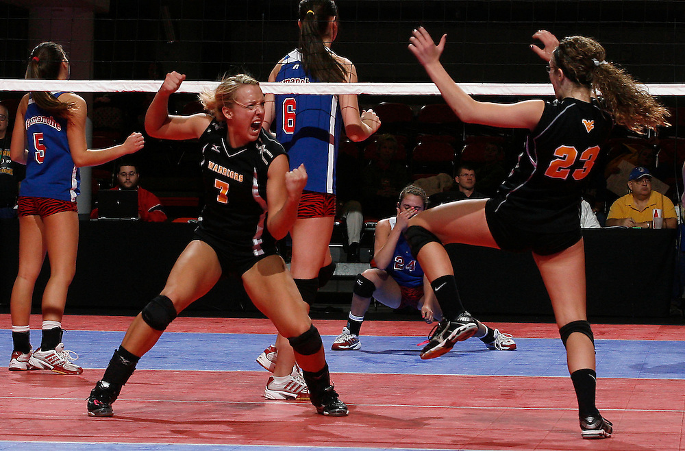Wapsie Valley's Eryca Hingtgen (7) and Aarika Wittenburg (23) celebrate a point against Camanche during the state volleyball 2A quarterfinals at the US Cellular Center in Cedar Rapids on Wednesday, November 11, 2009. (Crystal LoGiudice/The Gazette).