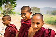 """01 MARCH 2014 - MAE SOT, TAK, THAILAND: Buddhist novice monks in a Burmese community in the forest a few kilometers north of Mae Sot. Mae Sot, on the Thai-Myanmer (Burma) border, has a very large population of Burmese migrants. Some are refugees who left Myanmar to escape civil unrest and political persecution, others are """"economic refugees"""" who came to Thailand looking for work and better opportunities.    PHOTO BY JACK KURTZ"""