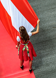 09.07.2017, Red Bull Ring, Spielberg, AUT, FIA, Formel 1, Grosser Preis von Österreich, Rennen, im Bild Formula Una Hostess mit einer Österreich Fahne // Formula Una Hostess with an Austrian flag during the Race of the Austrian FIA Formula One Grand Prix at the Red Bull Ring in Spielberg, Austria on 2017/07/09. EXPA Pictures © 2017, PhotoCredit: EXPA/ JFK