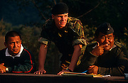 British and Nepali-born army officers assess recruits during an army exercise trial known as the British Fitness Test (BFT) at the British Gurkha Regiment's camp at Pokhara, Nepal. The boys are among those trying for a highly-valued place in the regiment after a gruelling series of tests to eliminate the weaker and less able candidates. 60,000 boys aged between 17-22 (or 25 for those educated enough to become clerks or communications specialists) report to designated recruiting stations in the hills each November, most living from altitudes ranging from 4,000-12,000 feet. After initial selection, 7,000 are accepted for further tests from which 700 are sent down here to Pokhara in the shadow of the Himalayas. Only 160 of the best boys succeed in the journey to the UK. Nepal has been supplying youth for the British army since the Indian Mutiny of 1857.