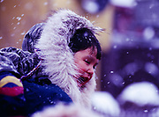 Young girl in Nome enjoying the finish of the Iditarod Sled Dog Race, Alaska.