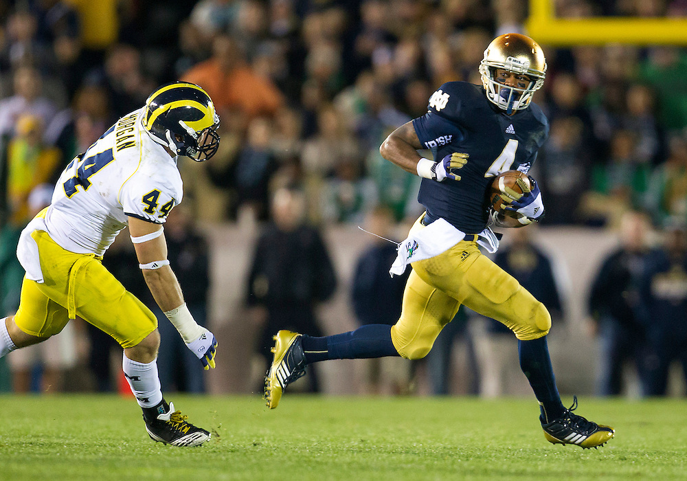 September 22, 2012:  Notre Dame running back George Atkinson III (4) runs for yardage as Michigan linebacker Desmond Morgan (44) defends during NCAA Football game action between the Notre Dame Fighting Irish and the Michigan Wolverines at Notre Dame Stadium in South Bend, Indiana.  Notre Dame defeated Michigan 13-6.