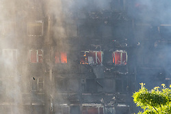 London, June 14th 2017. A fire rages through a residential tower block, Grenfell Tower, in Kensington, West London, with the entire building engulfed in flames. More than 200 firefighters are attending the incident and there are reports of people trapped inside. No figures are available as to casualties.
