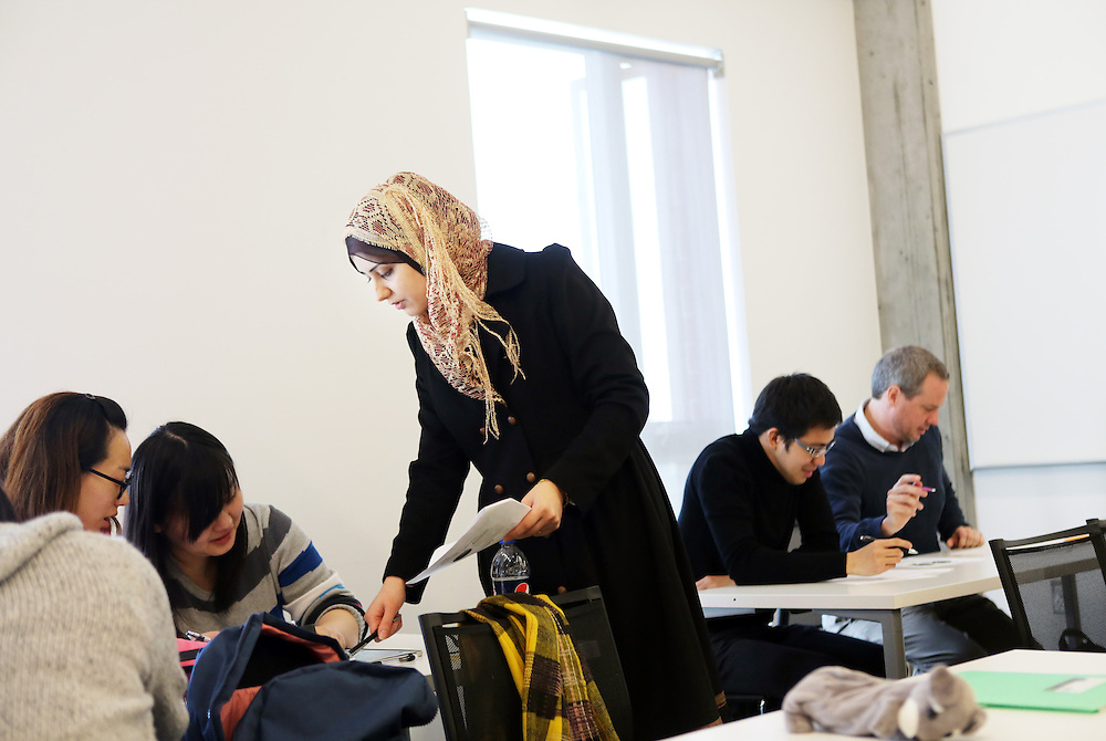 Student Shahad Shafee helps lead Ernest Shirosky's class on American-style academic learning. An unusual effort to assimilate foreign students and prepare them for attending an American university is run jointly by a private company, INTO, and Oregon State University in Corvallis, Ore. The students live and study in a campus building, the International Living-Learning Center.