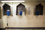 The three telephones (one off the hook) for prisoners to use on Benbow wing inside HMP/YOI Portland, a resettlement prison with a capacity for 530 prisoners. Dorset, United Kingdom.