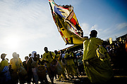 The flag-bearer of the #4 Asafo company swings his flag around while his companions play drums during the annual Oguaa Fetu Afahye Festival in Cape Coast, Ghana on Saturday September 6, 2008.
