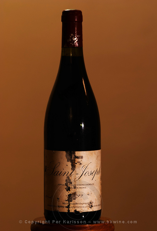 An old bottle of Saint Joseph 1992 by Jean-Louis Grippat with torn and mouldy label. JL Grippat has been sold to Guigal.  Saint Joseph, Rhone, France, Europe