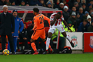 Bruno Martins Indi of Stoke City (r) holds he's head following a clash with Alex Oxlade-Chamberlain of Liverpool. Premier league match, Stoke City v Liverpool at the Bet365 Stadium in Stoke on Trent, Staffs on Wednesday 29th November 2017.<br /> pic by Chris Stading, Andrew Orchard sports photography.