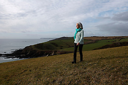 UK ENGLAND FOWEY 20FEB15 - Writer Tatiana De Rosnay walks through Allday Fields along the cliffs near St. Catherine's Castle outside  Fowey, Cornwall, England. Fowey, a small fishing and harbour village was the living place of famous English writer Daphne Du Maurier and many of her novels are based here.<br /> <br /> jre/Photo by Jiri Rezac<br /> <br /> © Jiri Rezac 2015