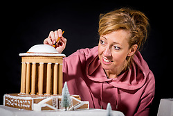 © Licensed to London News Pictures. 16/11/2017. Castle Howard UK. Bretta Gerecke puts the finishing touches to a huge Gingerbread replica of Castle Howard created by architectural food designers, Bompas & Parr that has been unveiled at Castle Howard as part of the estates Christmas season. Photo credit: Andrew McCaren/LNP