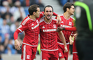 Middlesbrough FC striker Enrique Garcia scores the opening goal  during the Sky Bet Championship match between Brighton and Hove Albion and Middlesbrough at the American Express Community Stadium, Brighton and Hove, England on 19 December 2015.