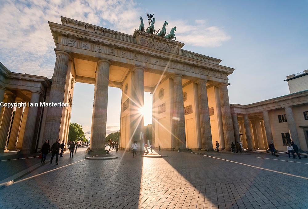 Evening sun shining through Brandenburg Gate in Berlin Germany