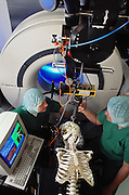 "Researcher Tim Leuth and surgeon Martin Klein with a medical robot called a ""SurgiScope"" at the Virchow Campus Clinic, Humboldt University, Berlin, Germany. The SurgiScope is an image guided surgery support device comprised of a robotic tool holder, advanced image handling software and a position sensor. The robotic system can be used for surgical planning and interoperative guidance."