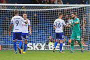 Bury striker Jermaine Beckford (9) celebrates with Bury defender Phil Edwards (14) and Bury midfielder Jay O'Shea (26) celebrates with Bury goalkeeper Leonardo Fasan (38) during the EFL Sky Bet League 1 match between Bury and Bradford City at the Energy Check Stadium at Gigg Lane, Bury, England on 14 October 2017. Photo by Richard Holmes.