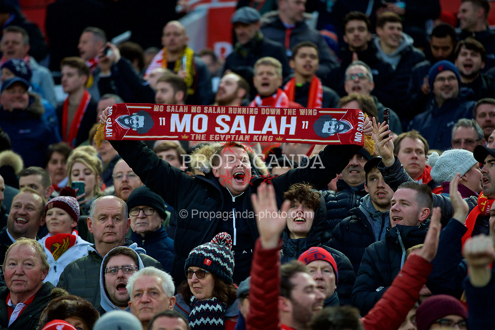 LIVERPOOL, ENGLAND - Wednesday, April 4, 2018: A Liverpool supporter with a scarf featuring Mohamed Salah during the UEFA Champions League Quarter-Final 1st Leg match between Liverpool FC and Manchester City FC at Anfield. (Pic by David Rawcliffe/Propaganda)