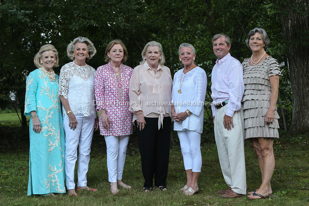 (7/25/20, WELLESLEY, MA) Siblings from left to right, Mary McDonnell Davidson, Sally Maloney, Kathy Wasilco, Ellen Walsh, Peggy Shepard, Jim O'Neal, and Nancy Holloway pose for a photo during the ALS fundraiser at the Walsh home in Wellesley on Saturday. [Daily News and Wicked Local Photo/Dan Holmes]