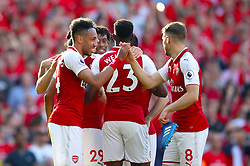 Arsenal's Pierre-Emerick Aubameyang (left) celebrates scoring his side's fifth goal of the game
