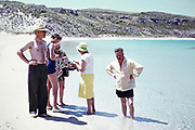 British holidaymakers standing on sandy beach two couples, Mediterranean holiday 1966