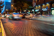 Beirut, Lebanon - September 23, 2010: Cars drive down Hamra Street in the early evening. Across the street is a Starbucks, and in the left of the photo is a sign for RadioShack.
