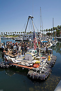 "On Sunday June 1, the raft named ""Junk""  left Long Beach for it's 2100 mile voyage to Hawaii to bring attention to the plastic marine debris (nicknamed the plastic soup) accumulating in the North Pacific Gyre. The raft was designed and will be sailed by Dr. Marcus Eriksen of the Algalita Marine Research Foundation, and Joel Paschal, it is constructed from 15,000 plastic bottles, an airplane fuselage, discarded fishing nets and a solar generator. The raft was towed for two and a half days to near San Nicholas Island, about 65 mile of the coast of California, so it could catch favorable winds for it's trip. The tow boat was the ORV Alguita, captained by Charlie Moore of the Algalita Marine Research Foundation, the man credited for first discovering the plastic soup in the Gyre over 12 years ago."