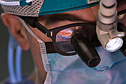 """The open chest cavity being retracted is seen reflected into the lens of the glasses of Mark W. Connolly, M.D., chief of Cardiovascular and Thoracic Surgery at St. Michael's Hospital, at the completion of a heart bypass procedure in the operating room of the hospital in Newark, New Jersey, Wednesday, January 17, 2007. Nisha Vachani, a Physician's Assistant observes.  This particular procedure is known as OPCAB--off-pump coronary artery bypass.  Although it involves opening the patient's chest cavity, it is called a """"minimally invasive"""" procedure since the patient's heart is operated on while still beating, avoiding use of the heart lung machine which is known to add considerable stress to a patient's body.  Special instruments are used to stabilize the heart while the doctor performs surgery.  Many patients are being directed by doctors and consultants to have their heart problems treated with stents--a minimally invasive procedure that does not involve opening the chest cavity--rather than considering the conventional open-heart bypass procedure as a viable option.  It is believed that doctors and consultants pushing stents often do not fully inform their patients of the alternatives that exist, and there is mounting evidence to suggest that thousands of patients die each year who could have lived longer had they undergone bypass surgery."""