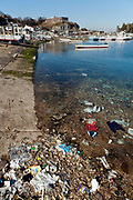 small fishers boat port with plastic trash in the water Yokosuka Japan