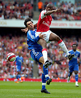 Photo: Ed Godden/Sportsbeat Images.<br /> Arsenal v Chelsea. The Barclays Premiership. 06/05/2007.<br /> Arsenal's Abou Diaby (R), climbs high above Paulo Ferreira.