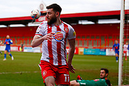 Danny Newton of Stevenage runs into the barrier chasing the ball during the EFL Sky Bet League 2 match between Stevenage and Harrogate Town at the Lamex Stadium, Stevenage, England on 6 March 2021.
