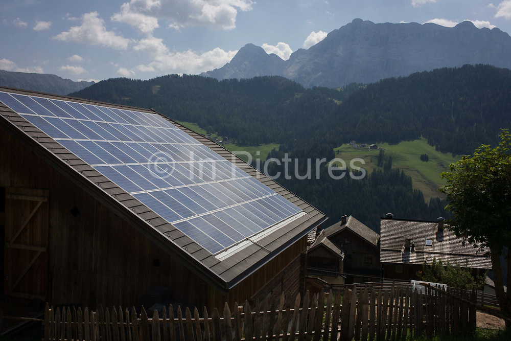 Solar panels on the roof of a Dolomites farm's barn roof in the old rural hamlet of Aireië, near Wengen-La Val, in south Tyrol, Italy. 60% of the province's energy needs, excl transport, comes from renewable sources like water, biomass, biogas, solar, wind and geothermal. In 2013 South Tyrol produced 6,569 gigawatt-hours of electricity and 92% of electrical energy was generated via hydropower homemade energy producing more than twice its own requirements. The South Tyrolean budget is 5bn Euros with only 10% leaving the region for government in Rome. The Überetsch (Oltradige in Italian) is a hilly section of the Etschtal in South Tyrol, northern Italy.
