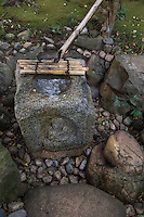 A chozuya or temizuya is a water basin for purification at Japanese temples and shrines. These water basins are used by worshipers for purifying their hands and mouth  before approaching a shrine or temple. The basins at temples or shrines are called chozubachi.  Very similar basins are found in Japanese gardens and tea ceremony huts but are called tsukubai.