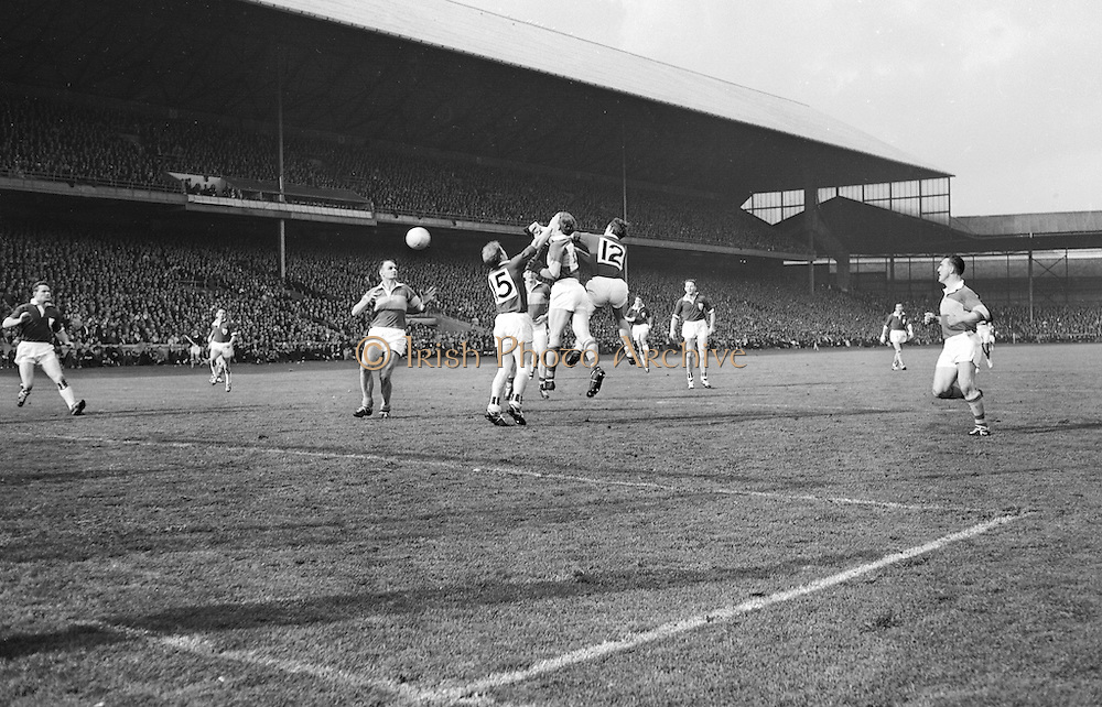 Kerry's Morris punches the ball to N. Sheehy during the All Ireland Senior Gaelic Football Final Kerry v. Galway in Croke Park on the 26th September 1965. Galway 0-12 Kerry 0-09.