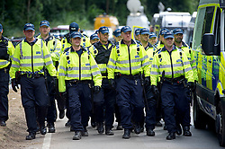 © London News Pictures. 19/08/2013. Balcombe, UK. Police prepare to attempt to remove activists from outside  the Cuadrilla drilling site in Balcombe, West Sussex on a day of of civil disobedience organised by campaign group No Dash For Gas. Cuadrilla has temporarily ceased drilling at the site, which has been earmarked for fracking, under advice from the police. Photo credit: Ben Cawthra/LNP