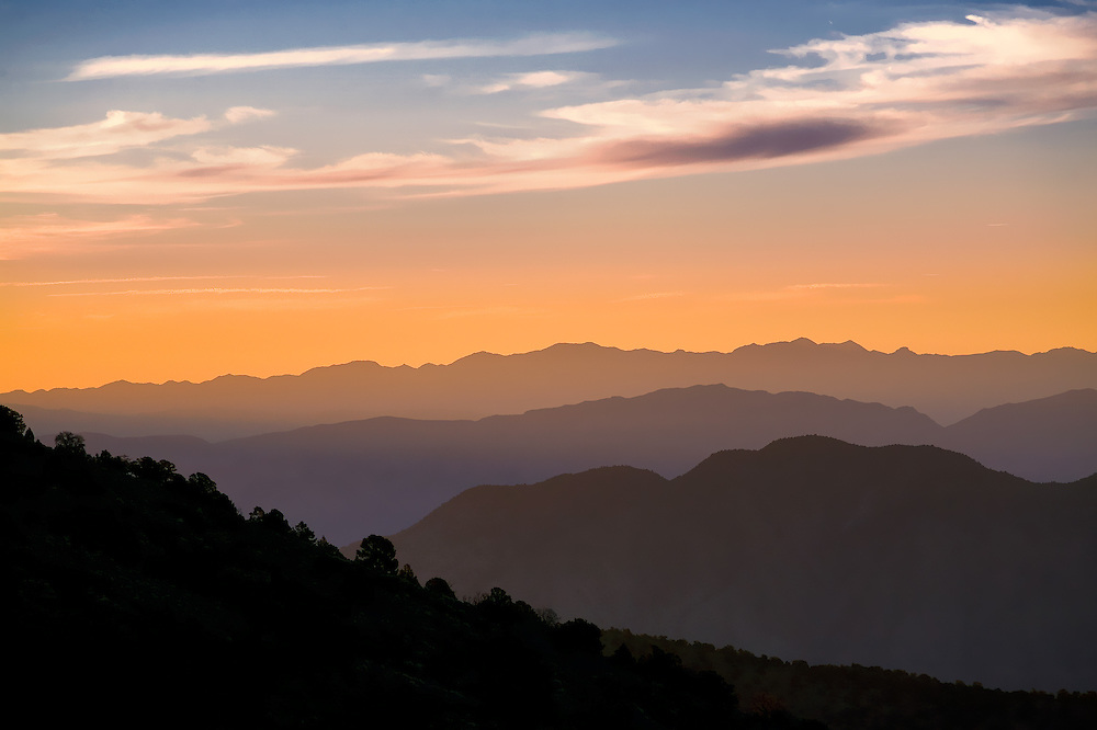 Alternating planes of light give depth to the sunrise on the White Mountains in California.