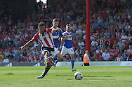 Andre Gray of Brentford scores his sides first goal of the game to make it 1-2. Skybet football league Championship match, Brentford v Ipswich Town at Griffin Park in London on Saturday 8th August 2015.<br /> pic by John Patrick Fletcher, Andrew Orchard sports photography.