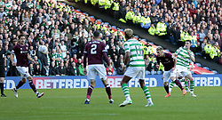 Celtic's Ryan Christie (right) scores their third goal against Heart of Midlothian during the Betfred Cup semi final match at BT Murrayfield Stadium, Edinburgh.