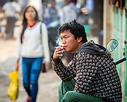 A contemplative smoke. Whilst the anti-smoking campaigns have gained momentum, Smoking remains popular across the country - along with chewing betel-nut. Cheroots (cigars with the end trimmed off), from the Tamil word curuttu continue to be made by hand in many of the village markets.