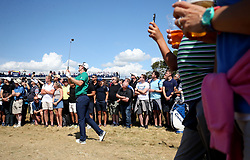 England's Justin Rose takes his 2nd shot on the 7th from outside the ropes during day one of The Open Championship 2018 at Carnoustie Golf Links, Angus.